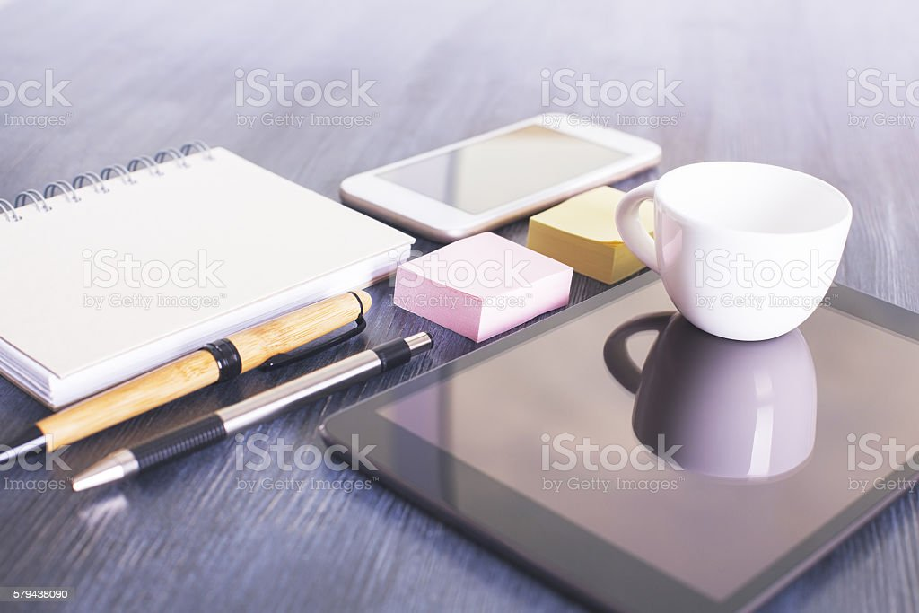 Tablet, phone and stationery stock photo