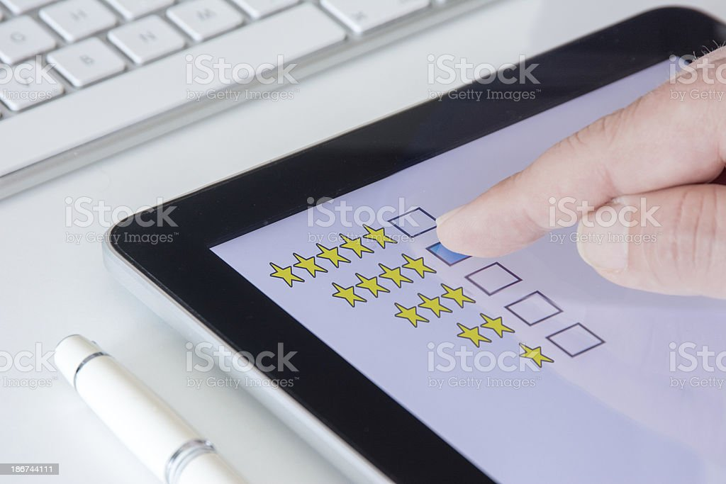 Tablet Questionnaire 4 stars stock photo