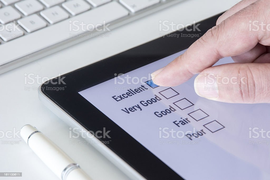 Tablet Questionnaire Excellent with finger reflection royalty-free stock photo