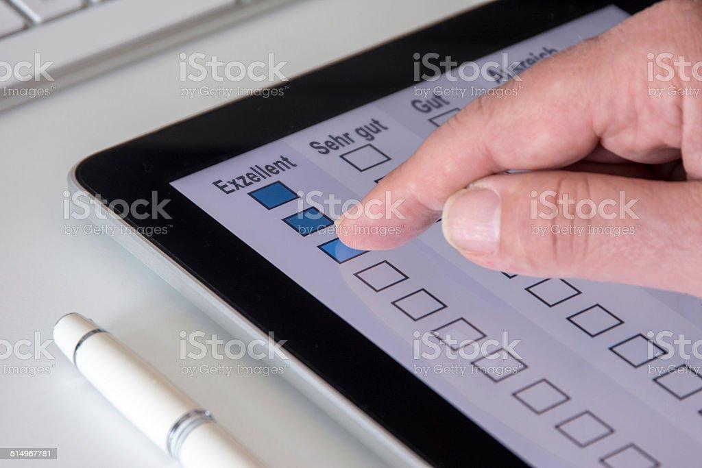 Tablet Questionnaire Exzellent (German) stock photo