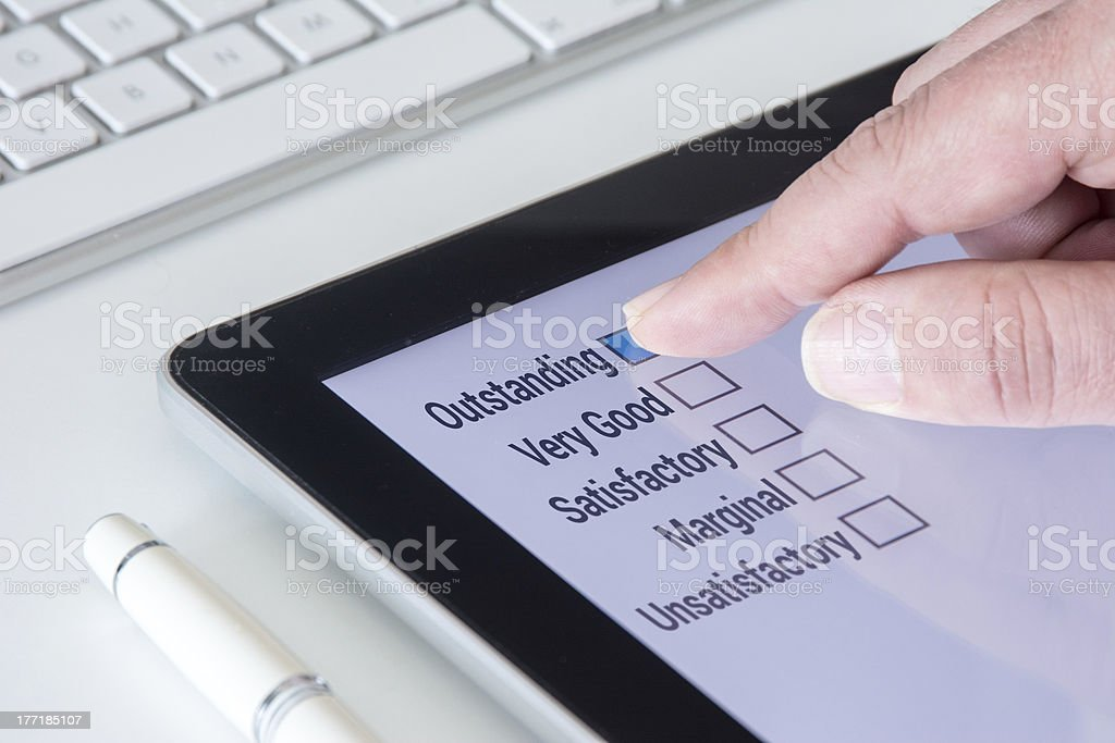 Tablet Questionnaire Outstanding list stock photo