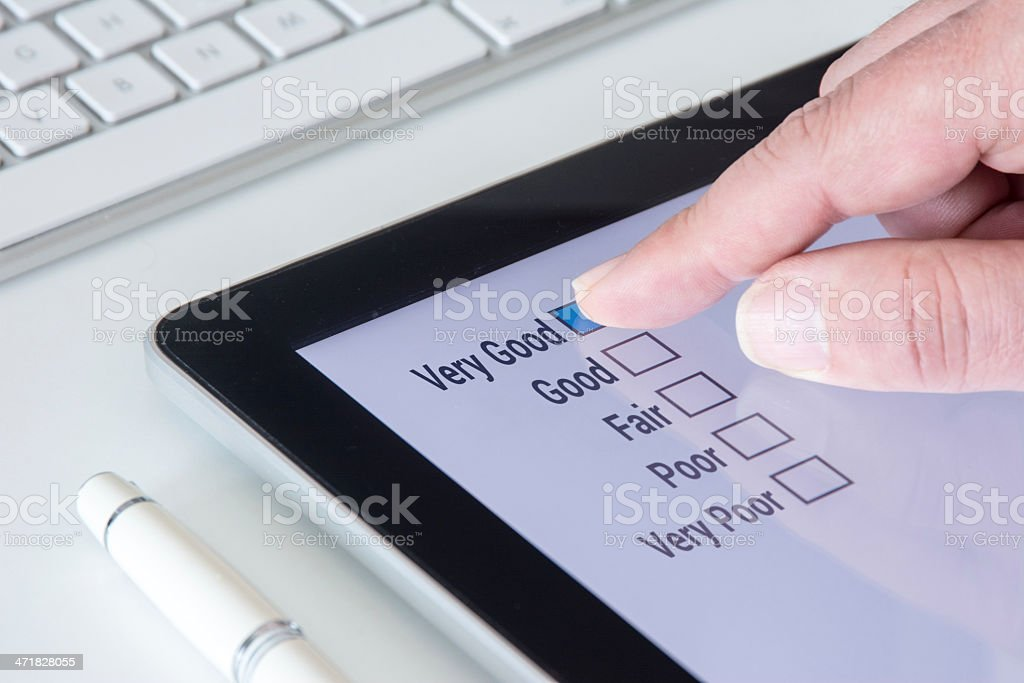 Tablet Questionnaire Very Good list stock photo