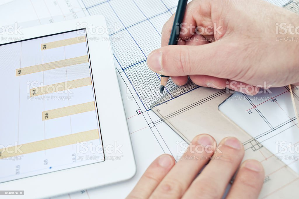 Tablet, Ruler And Plans On The Desk royalty-free stock photo