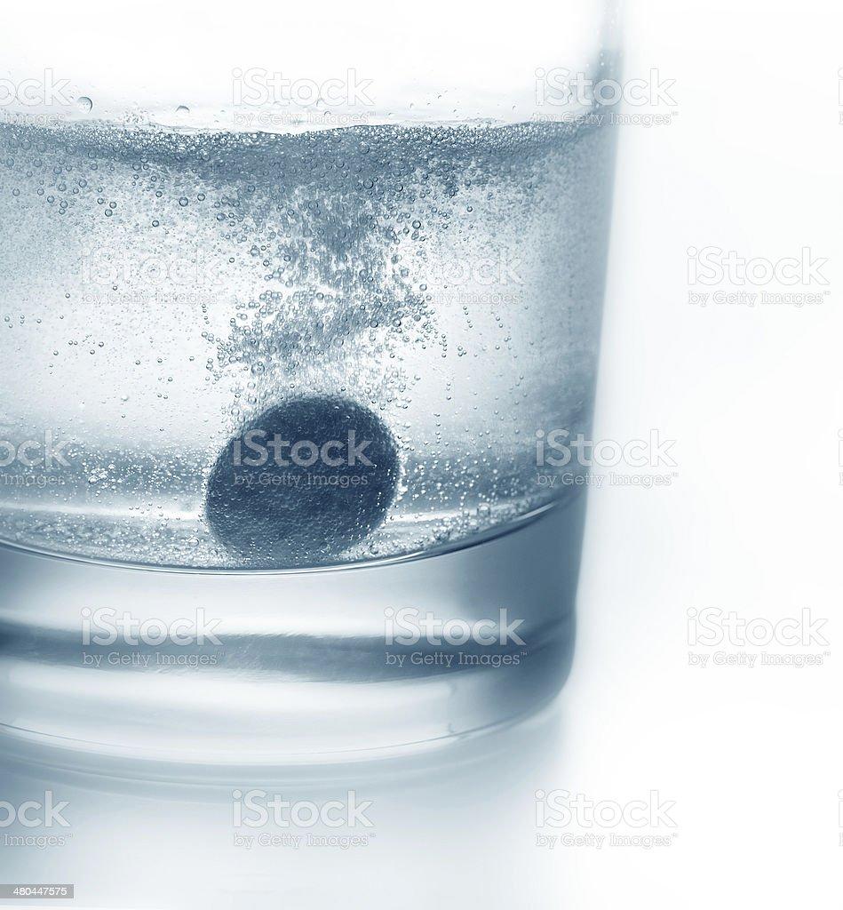 Tablet sinking stock photo