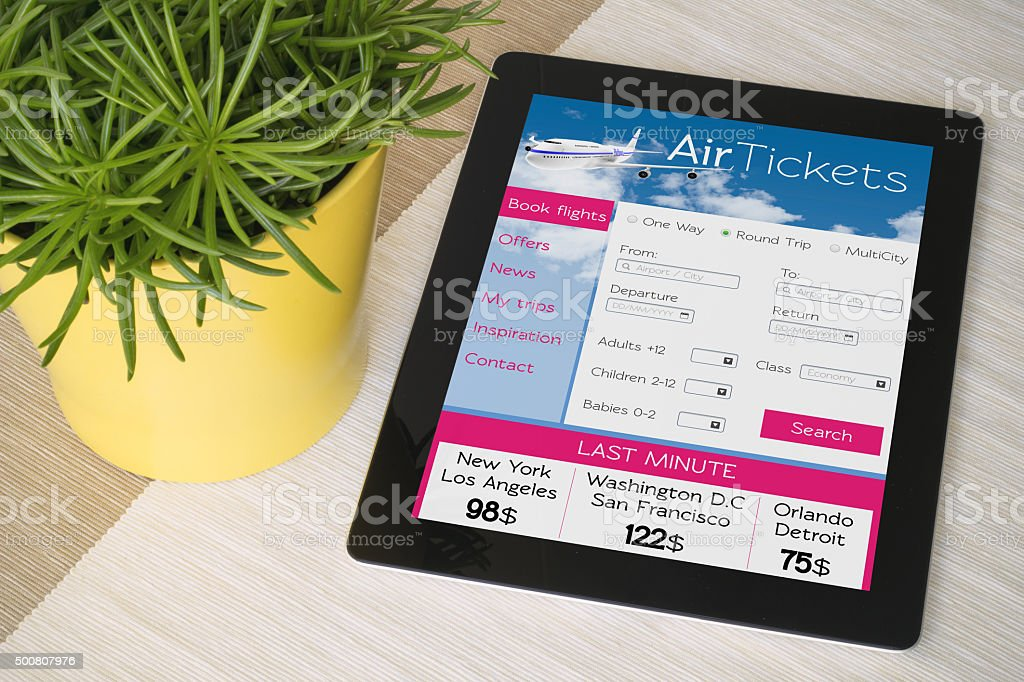 Tablet ticket web over a table with plant stock photo
