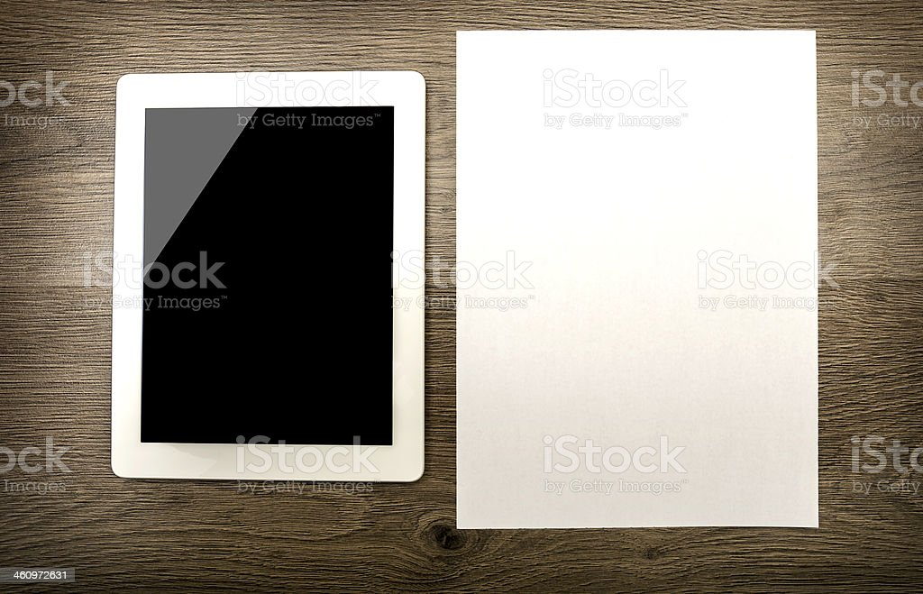 Tablet with an empty screen and paper stock photo