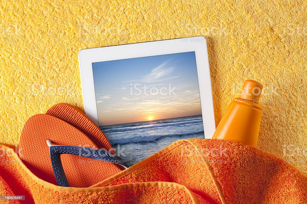 Tablet with beach accessories royalty-free stock photo