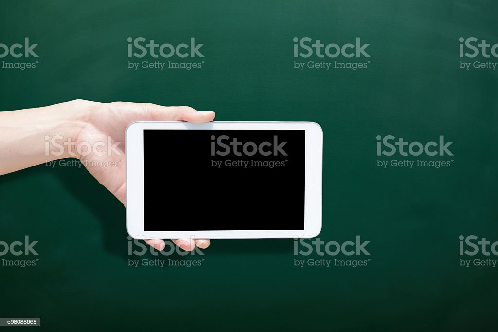 tablet with blank green chalkboard stock photo