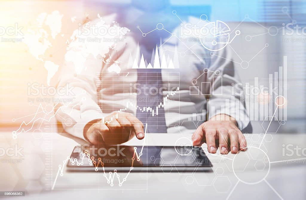 Tablet with business charts stock photo