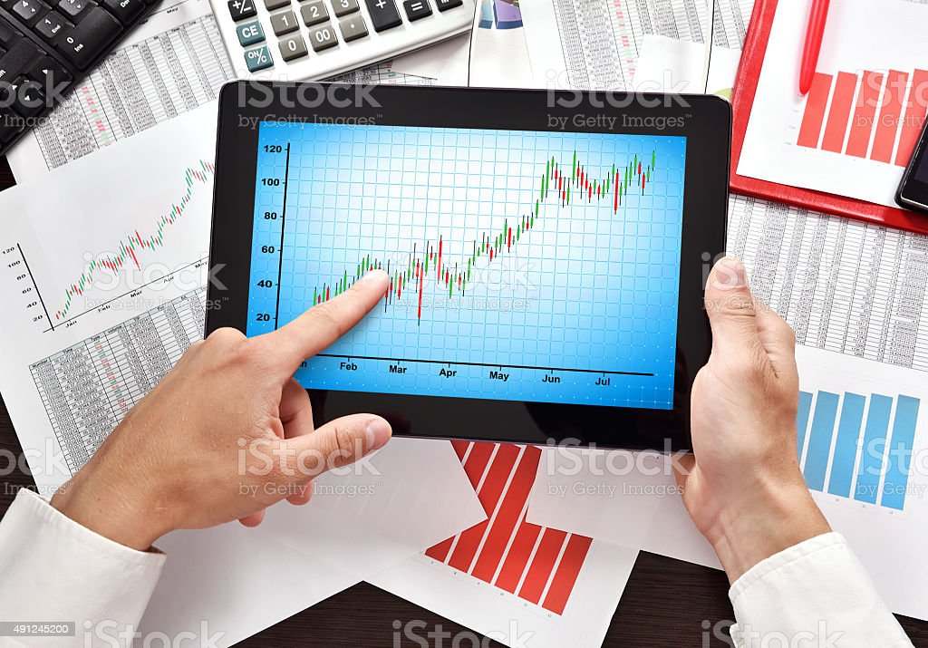 tablet with chart on screen stock photo