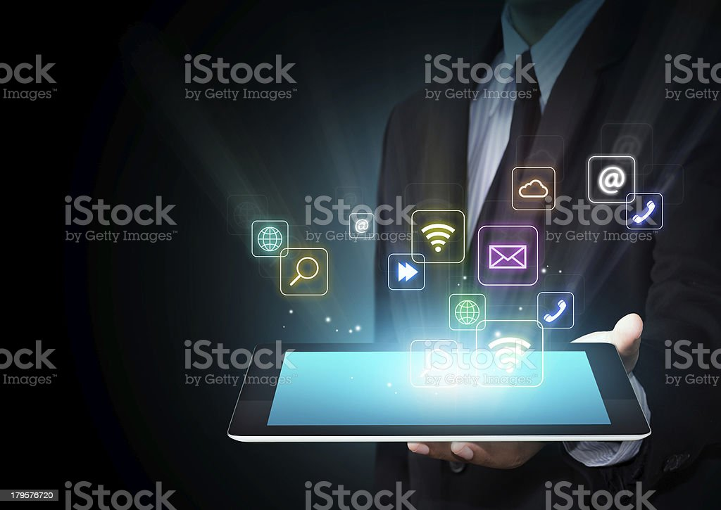 Tablet with cloud of colorful application icons stock photo