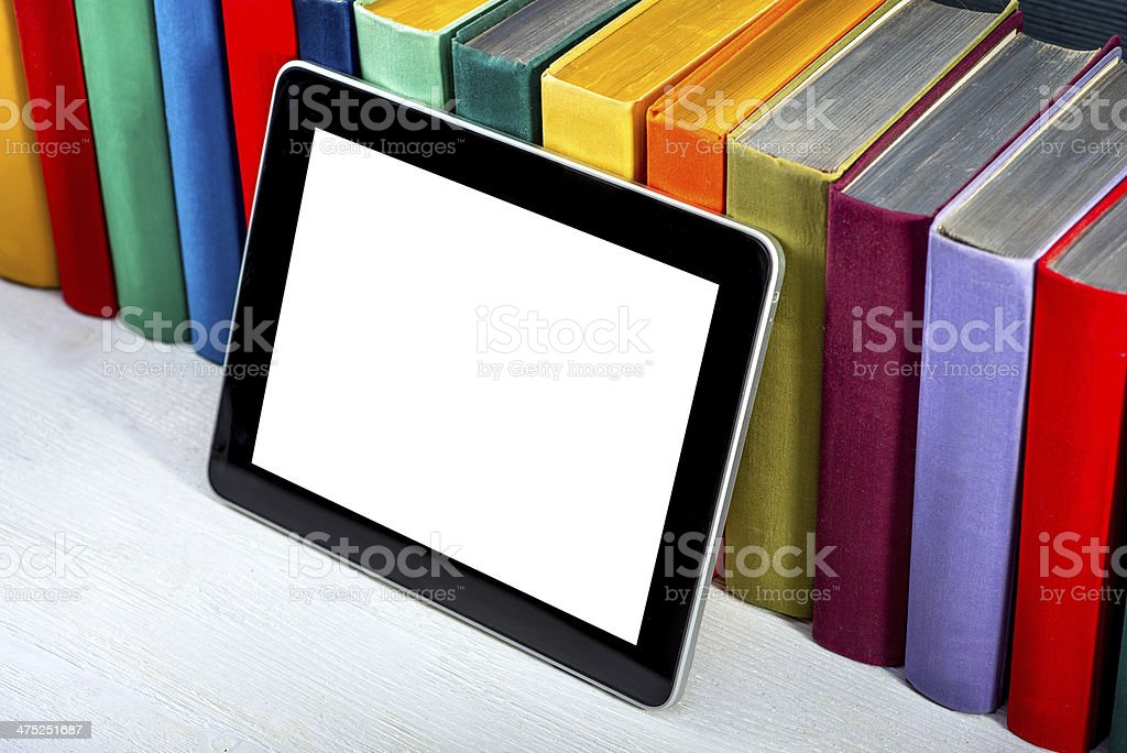 tablet with colorful books stock photo