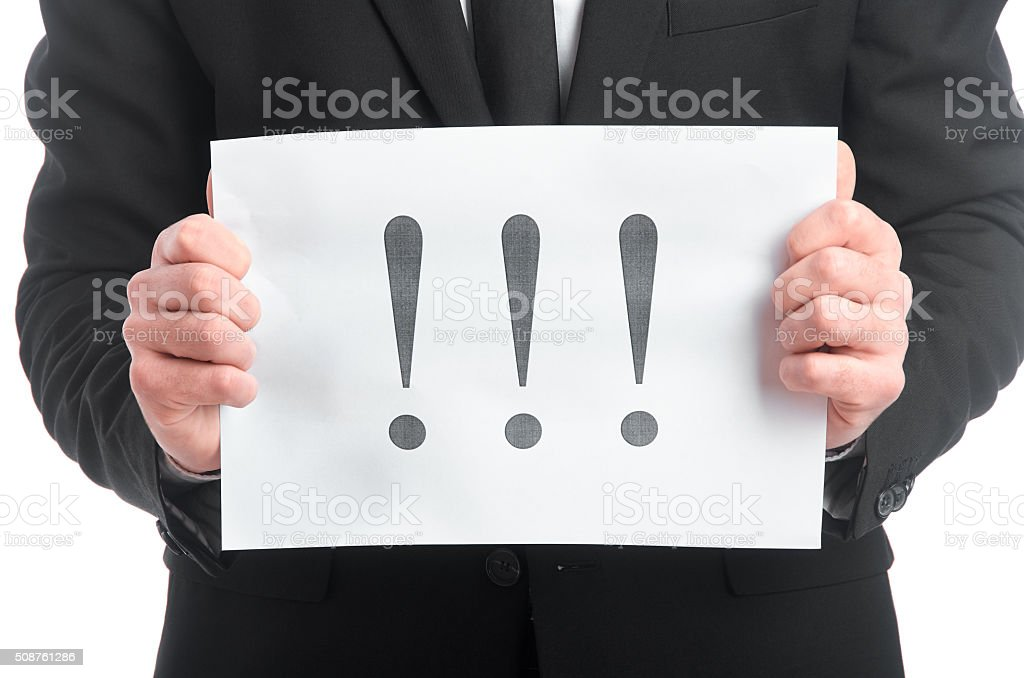 Tablet with exclamation point on it in man's hands stock photo