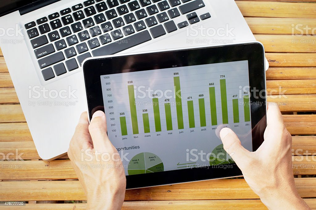 tablet with infographics on the screen stock photo