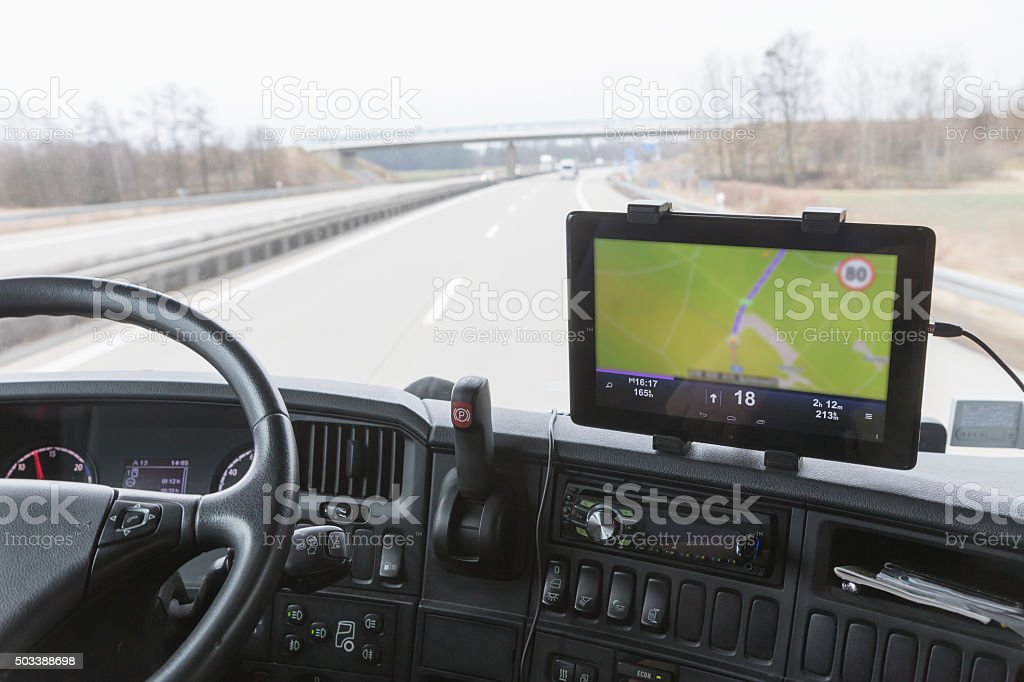 Tablet with navigation in truck cabin during drive stock photo