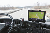Tablet with navigation in truck cabin during drive