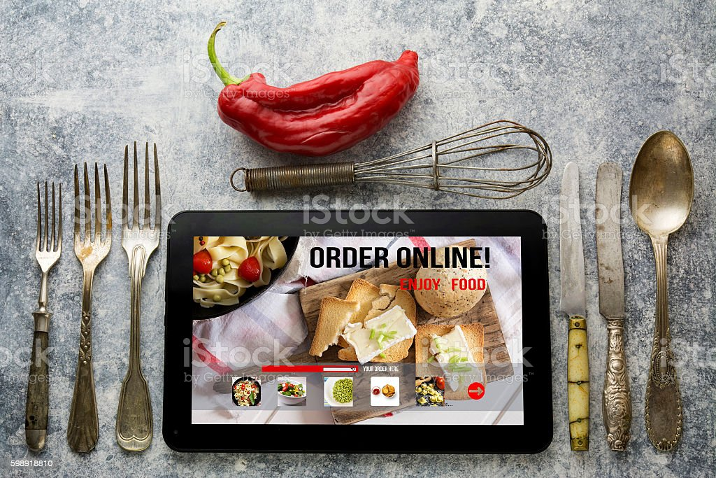 Tablet with Online food delivery app on screen. lifestyle concep stock photo