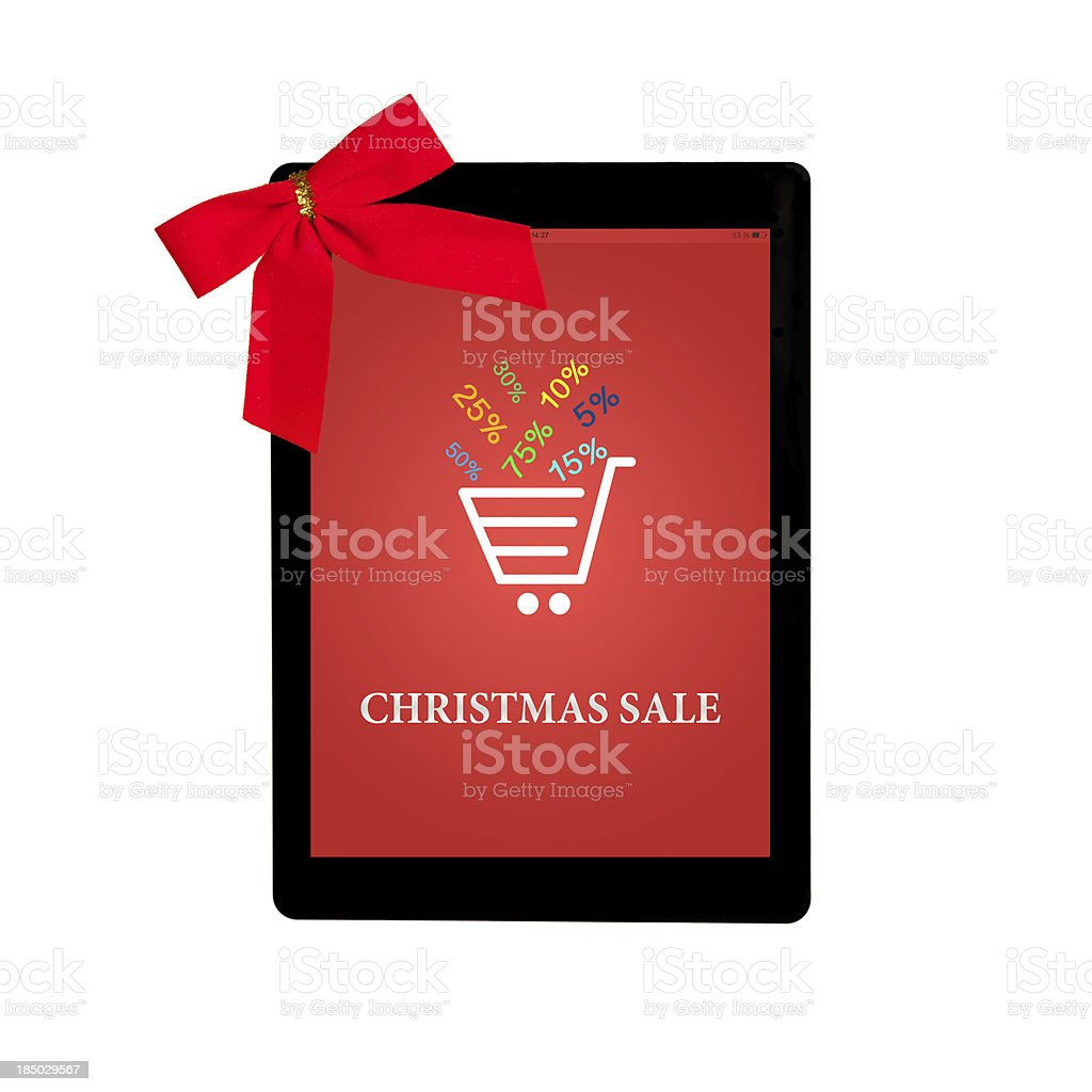 tablet with red gift bow and christmas sale a screen royalty-free stock photo