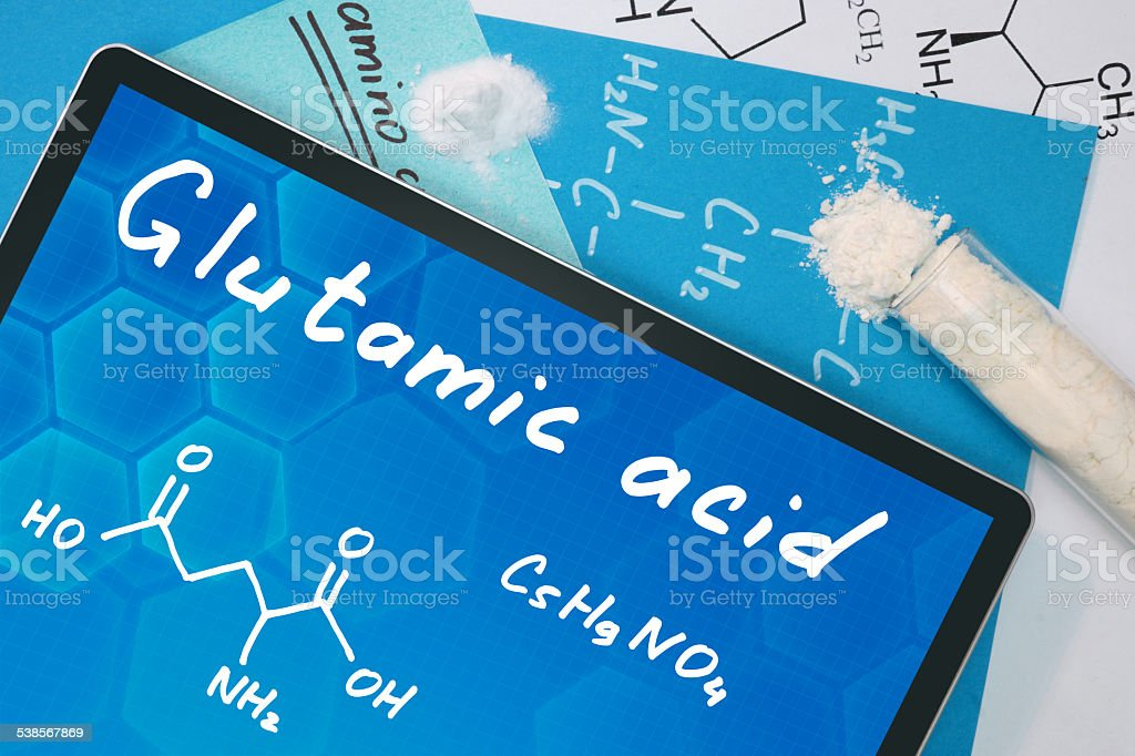 Tablet with the chemical formula of Glutamic acid. stock photo