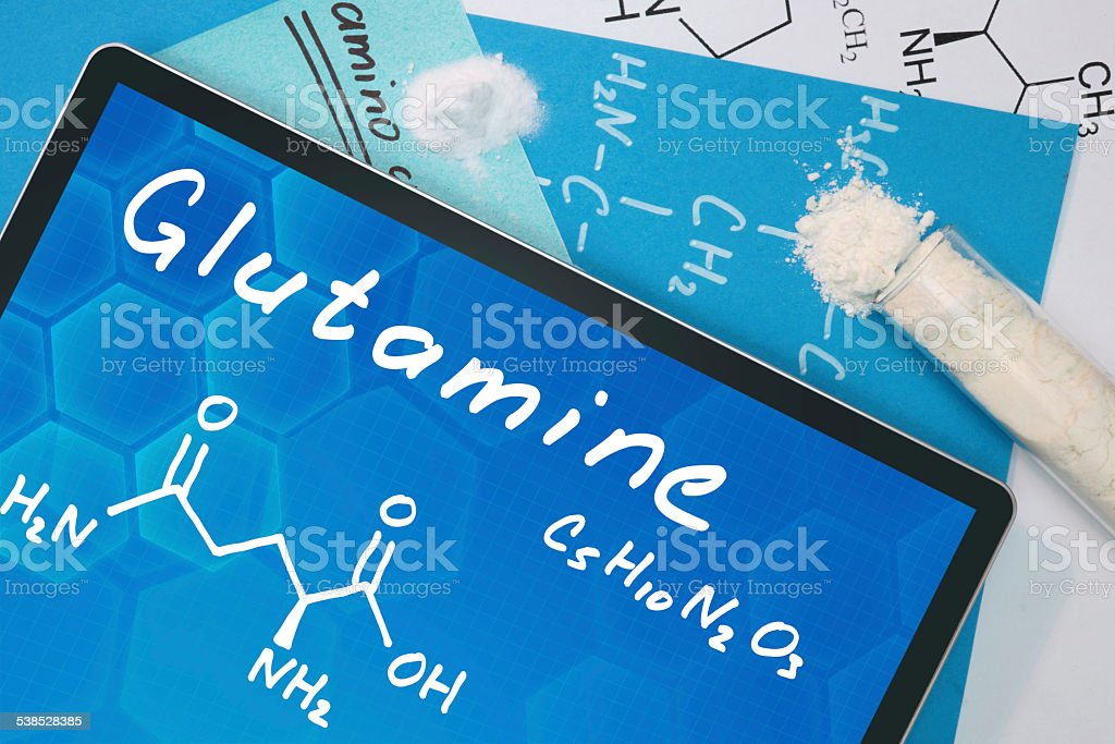 Tablet with the chemical formula of  Glutamine . stock photo