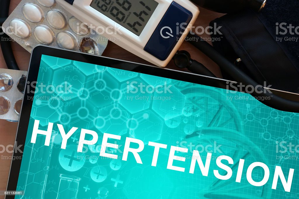 Tablet with the diagnosis hypertension stock photo