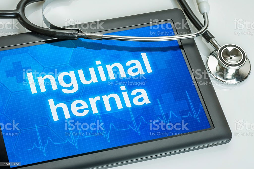 Tablet with the diagnosis Inguinal hernia on the display stock photo