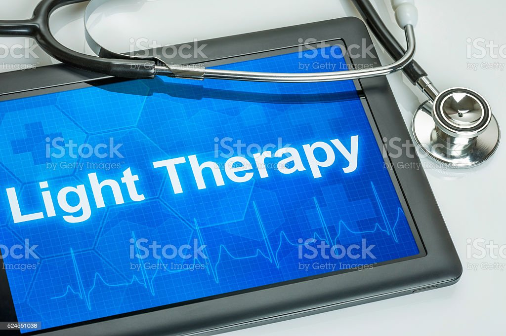 Tablet with the diagnosis Light Therapy on the display stock photo