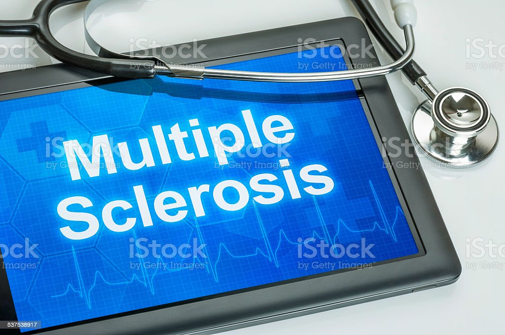 Tablet with the diagnosis multiple sclerosis on the display stock photo
