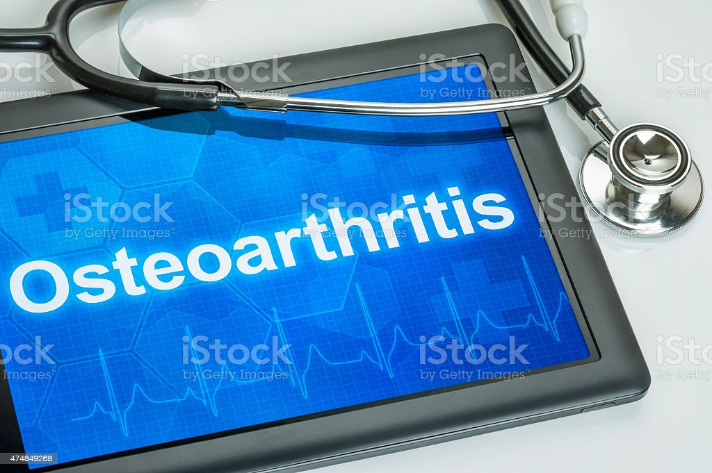Tablet with the diagnosis Osteoarthritis on the display stock photo