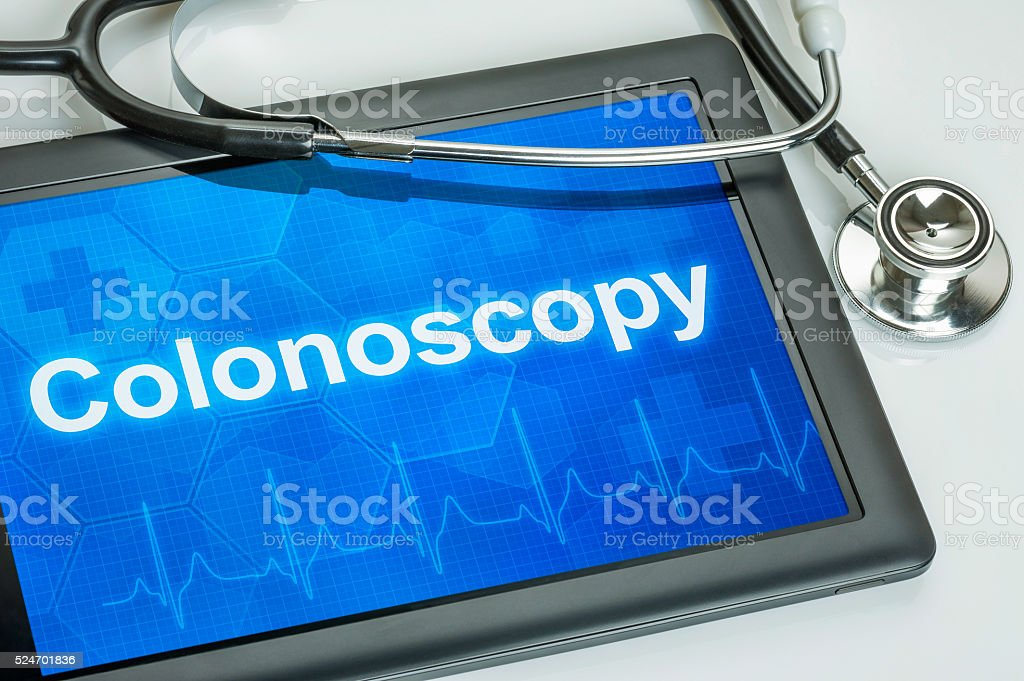 Tablet with the text Colonoscopy on the display stock photo