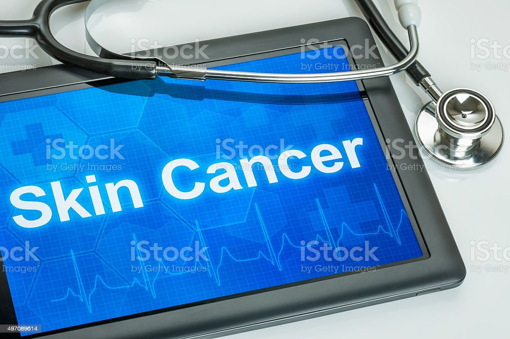 Tablet with the text Skin Cancer on the display stock photo