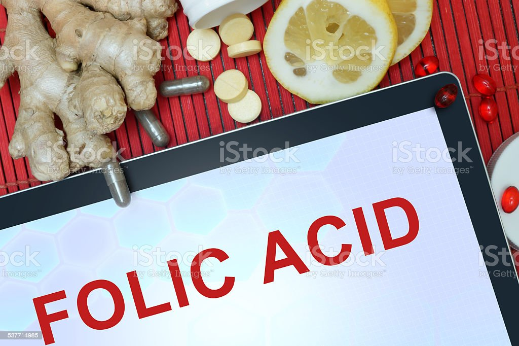 Tablet with words Folic acid. stock photo