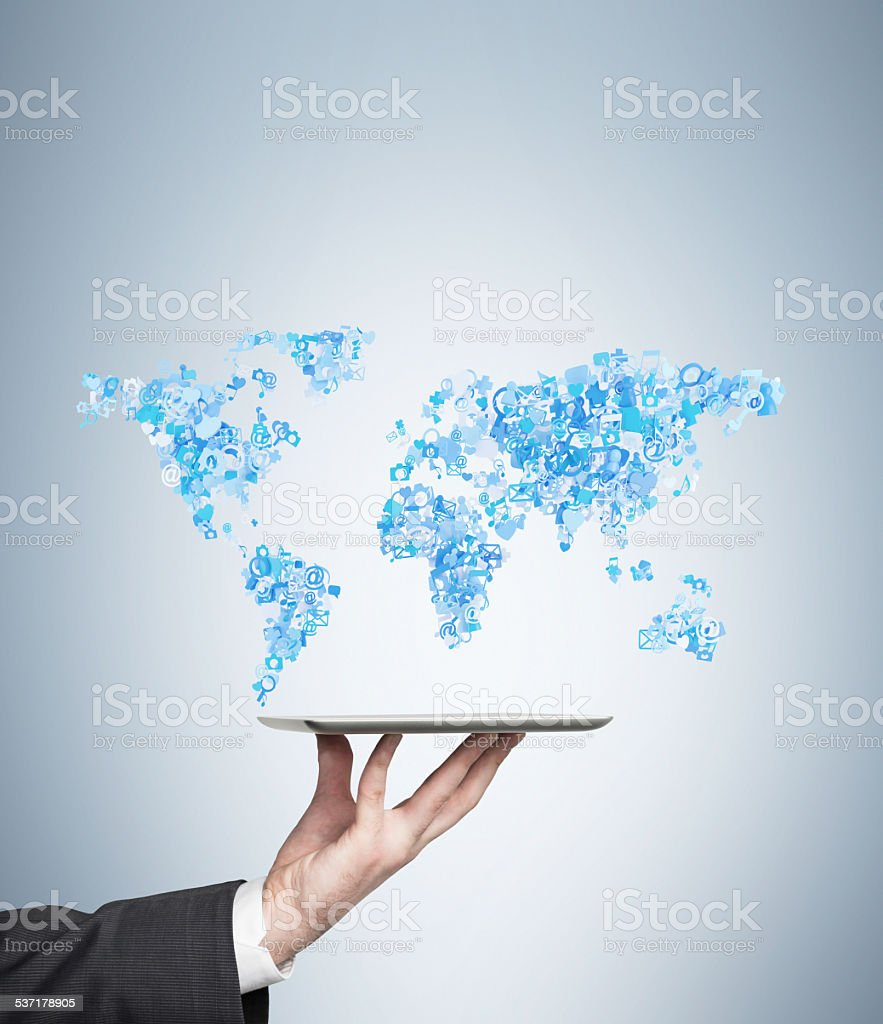 tablet with world map stock photo
