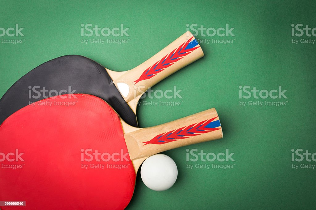 tabletennis racket and ball on table stock photo