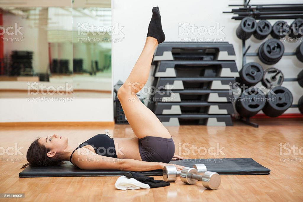 Tabletop crunches at the gym stock photo