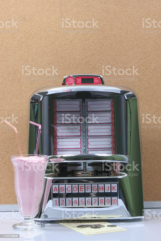 Tabletop jukebox and milkshake stock photo