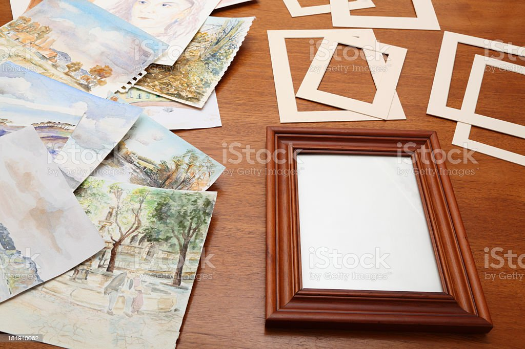 tabletop with watercolour paintings border mounts and frame royalty-free stock photo