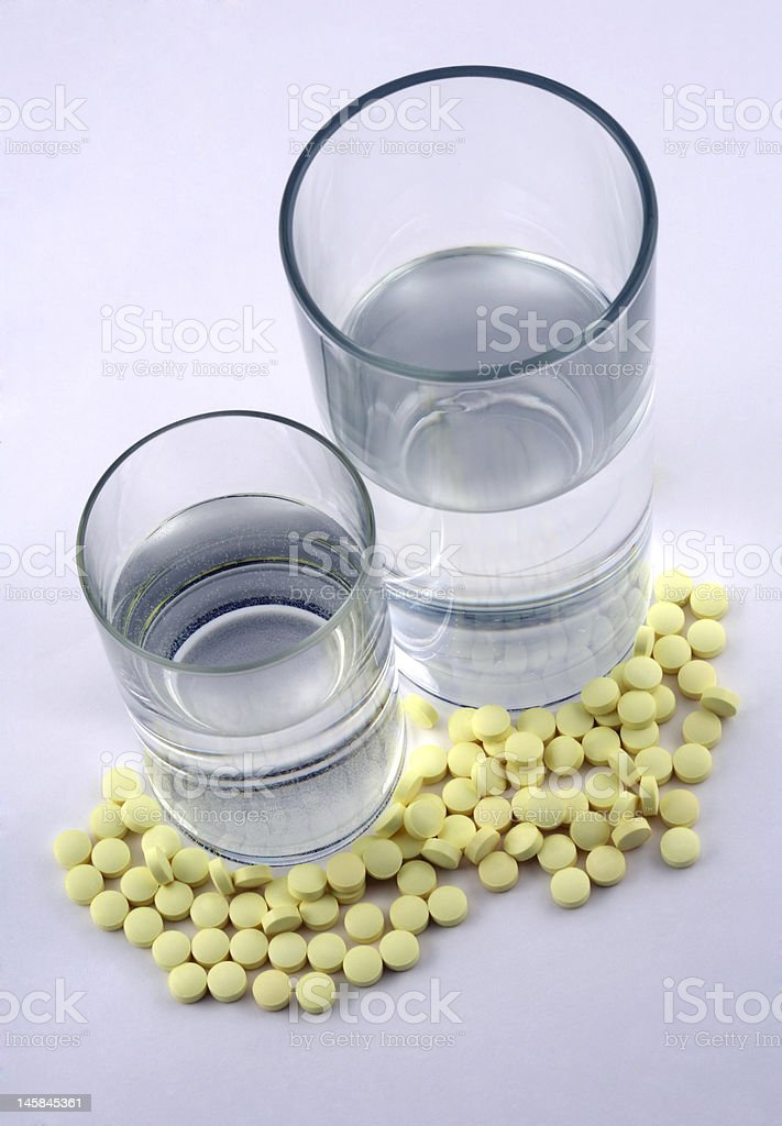 Tablets and a glass royalty-free stock photo
