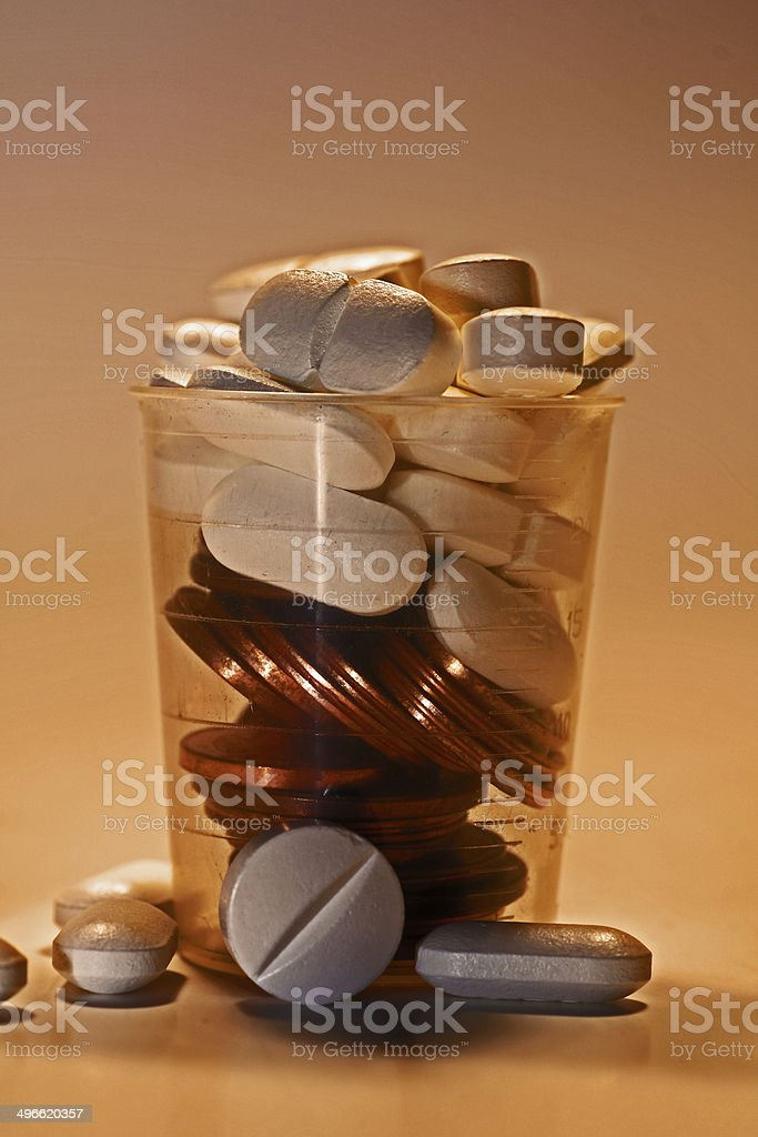 Tablets and Coins royalty-free stock photo