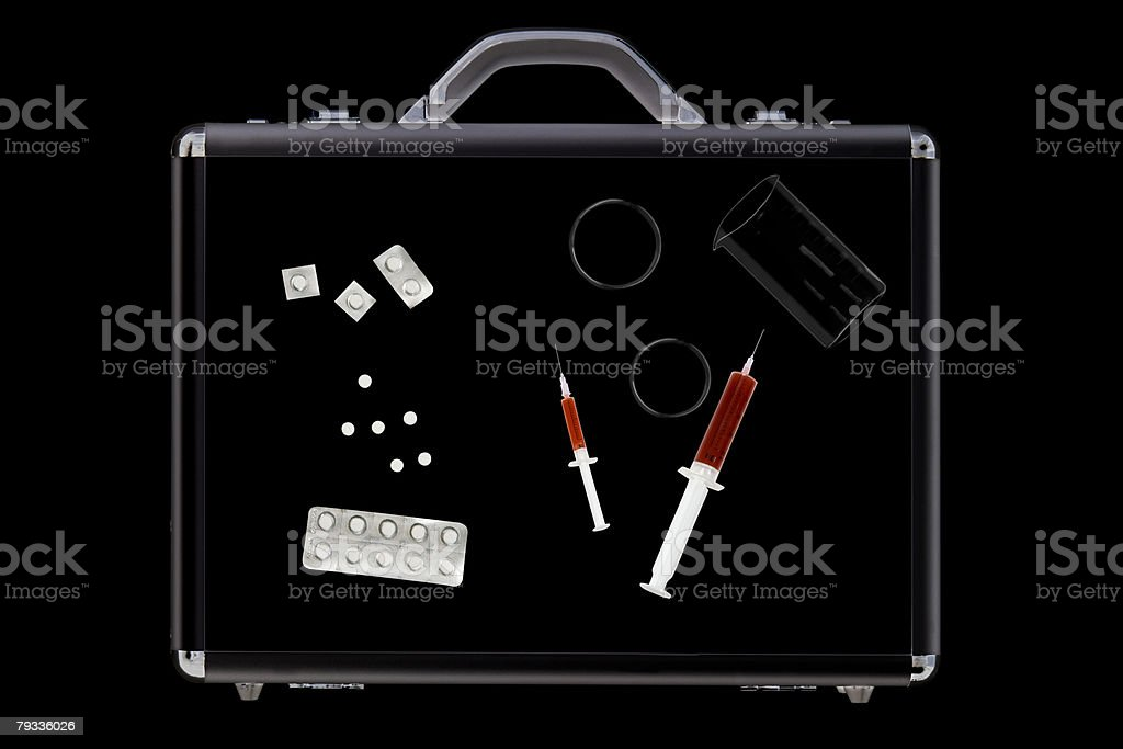 Tablets and syringes in briefcase royalty-free stock photo