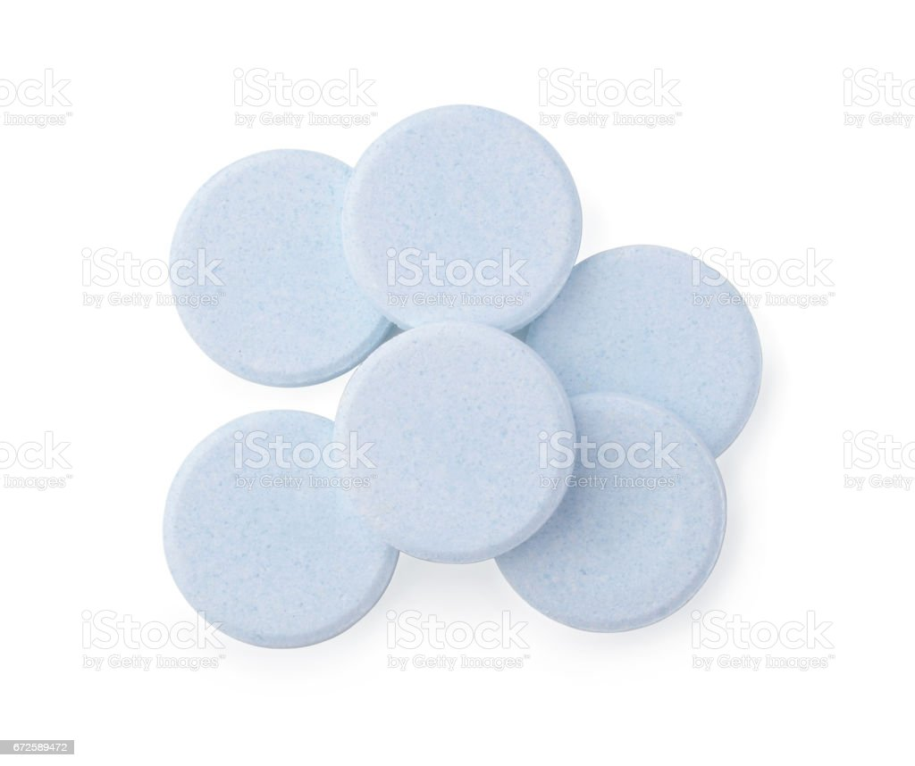 Tablets for cleaning of dental prostheses isolated on white stock photo