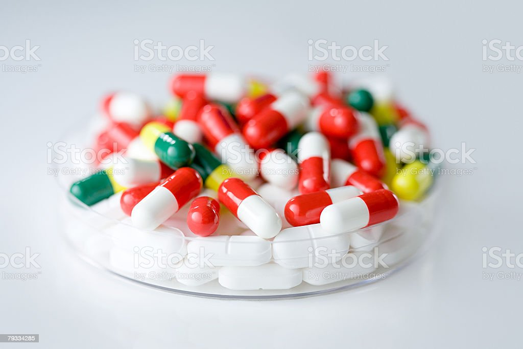Tablets in a petri dish royalty-free stock photo