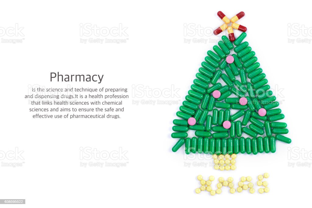 Tablets in form of Christmas tree and words under it stock photo