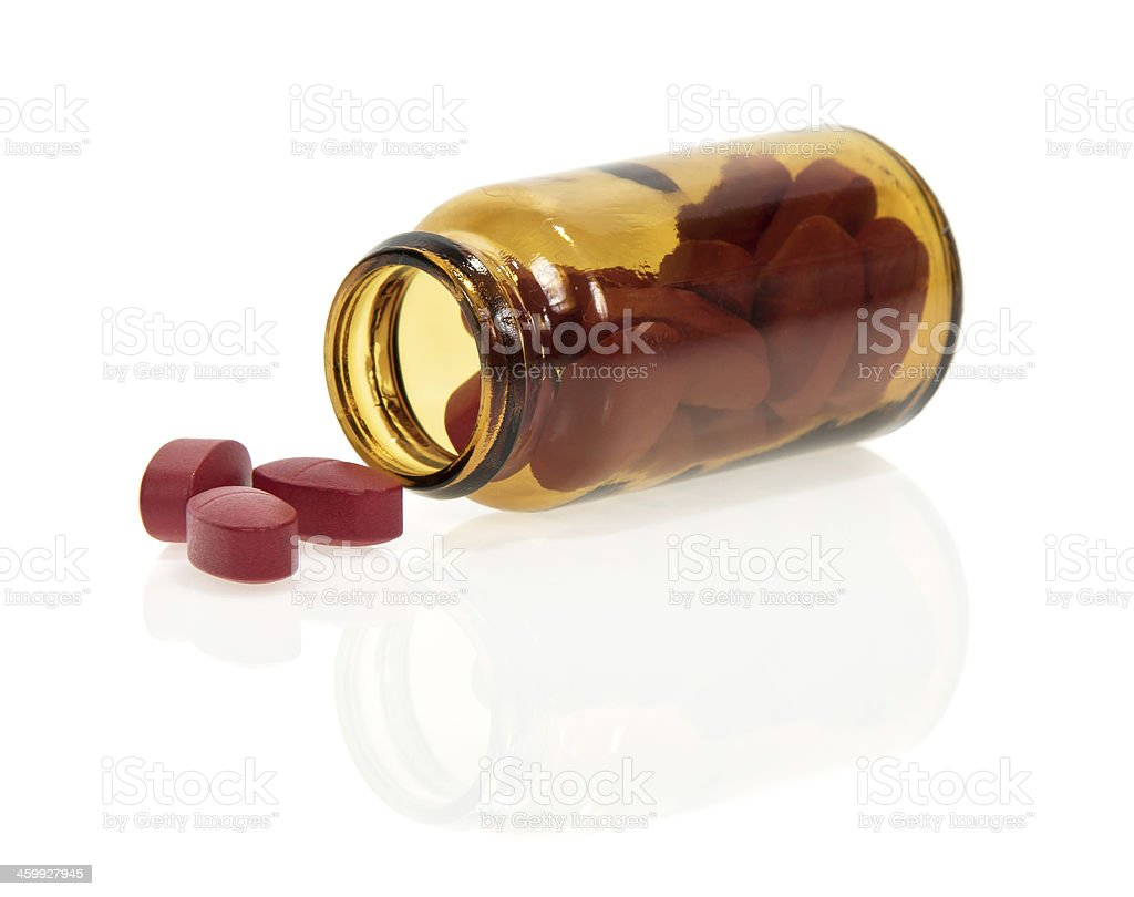 Tablets scattered from bottle royalty-free stock photo