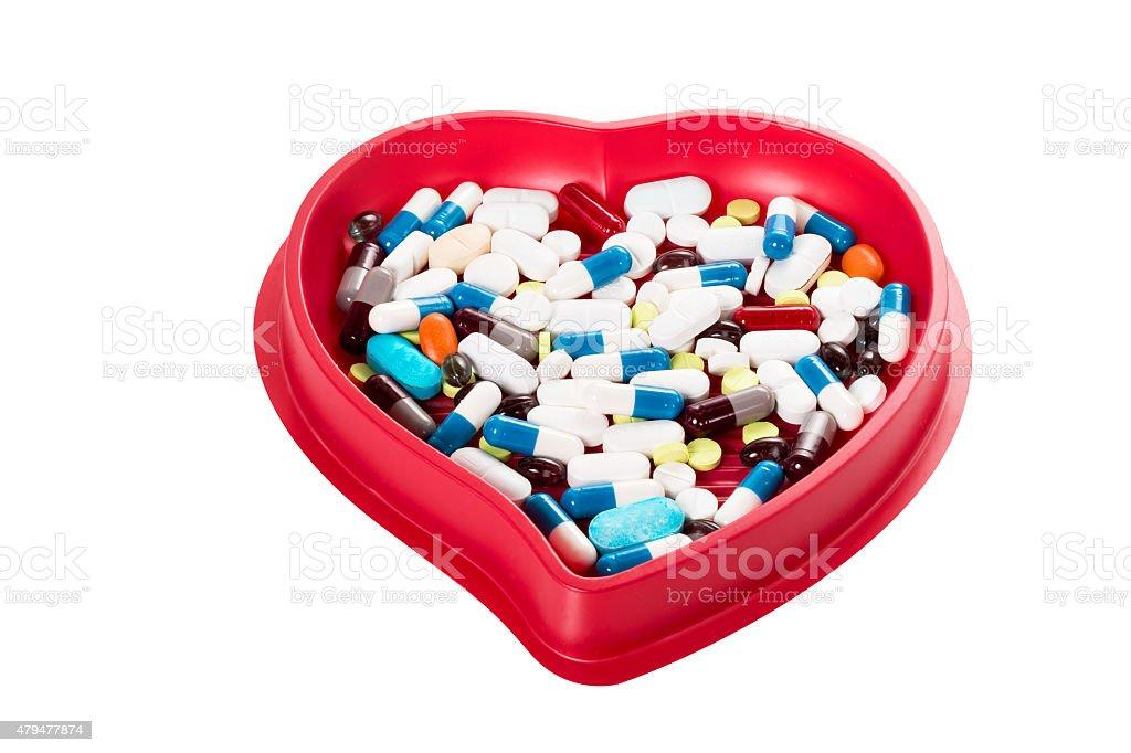 Tabletten in einer roten Herz Schale stock photo
