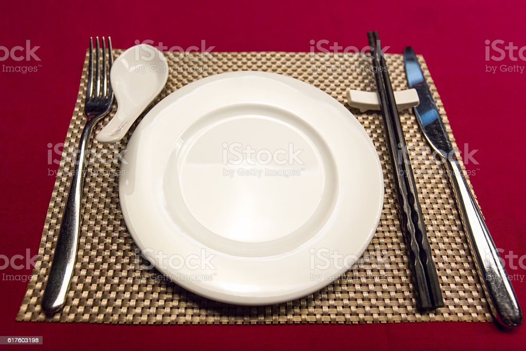 Tableware with golden pad put on red table stock photo