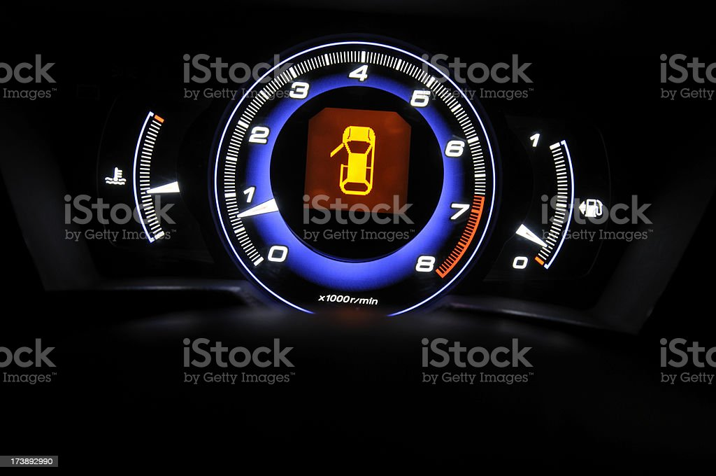 Tachometer and fuel gage royalty-free stock photo
