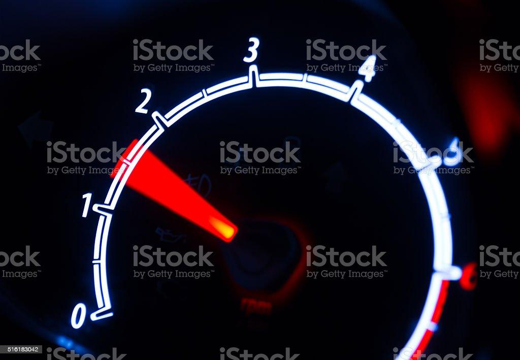 Tachometer illuminated at night stock photo