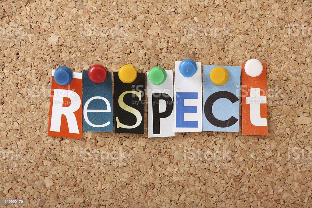 Tacked letters of different fonts spell out respect on cork stock photo