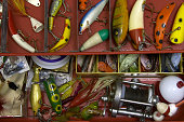 Tackle box filled with lures and hooks